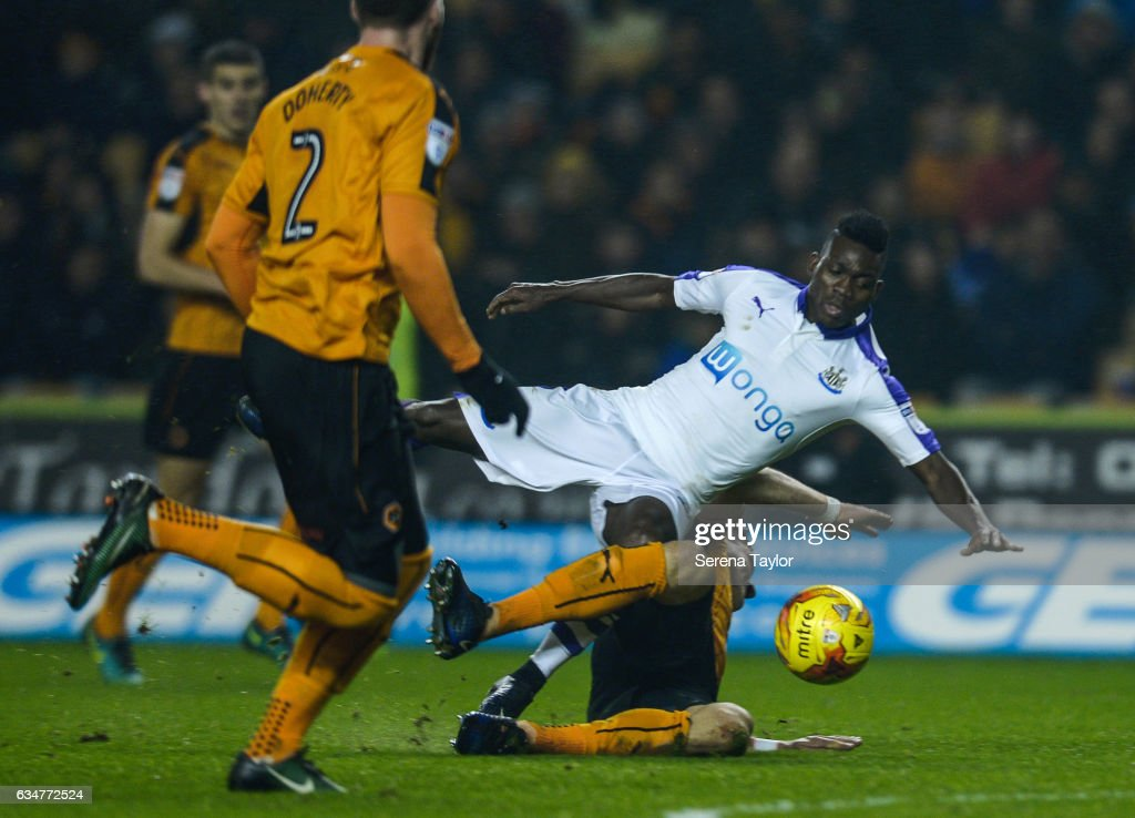 Christian Atsu of Newcastle United (30) is wiped out whilst chasing the ball during the Sky Bet Championship match between Wolverhampton Wanderers and Newcastle United at Molineux on February 11, 2017 in North Shields, England.