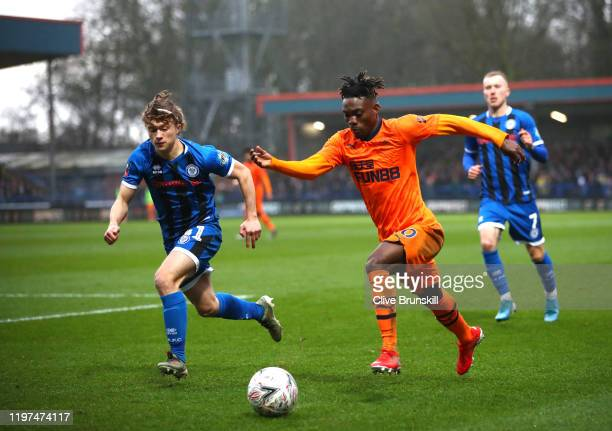 Christian Atsu of Newcastle United runs past Luke Matheson of Rochdale during the FA Cup Third Round match between Rochdale AFC and Newcastle United...