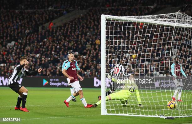 Christian Atsu of Newcastle United scores his sides third goal during the Premier League match between West Ham United and Newcastle United at London...