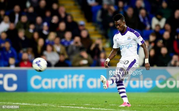 Christian Atsu of Newcastle United scores the opening goal from a free kick during the Sky Bet Championship match between Cardiff City and Newcastle...