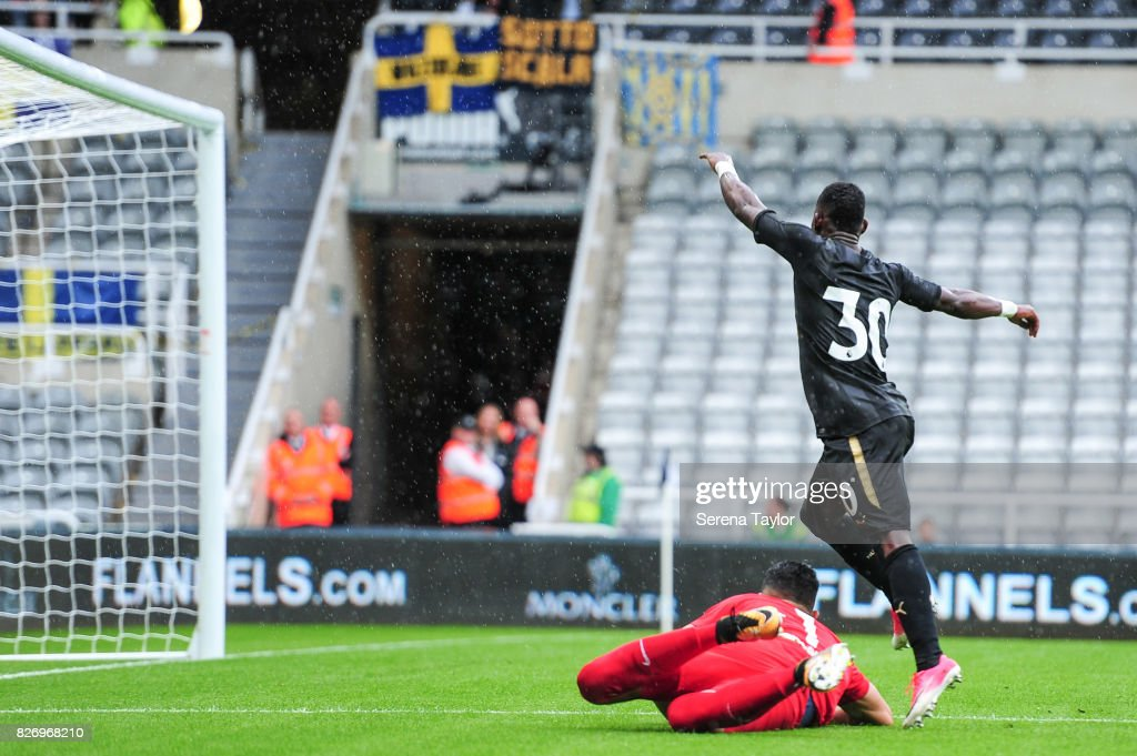 Christian Atsu of Newcastle United (30) scores the second goal past Hellas Verona Goalkeeper Nicholas (1) during the Pre Season Friendly match between Newcastle United and Hellas Verona at St.James' Park on August 6, 2017, in Newcastle upon Tyne, England.