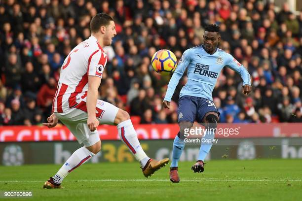 Christian Atsu of Newcastle United shoots and misses during the Premier League match between Stoke City and Newcastle United at Bet365 Stadium on...