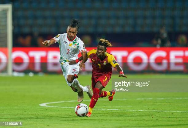 Christian Atsu Twasam of Ghana and David Djigla of Benin challenging for the ball during the 2019 African Cup of Nations match between Ghana and...