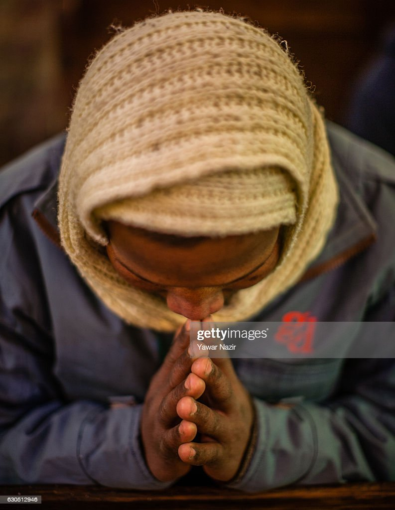 A Christian attends Christmas mass inside the Holy Family Catholic Church during Christmas on December 25, 2016 in Srinagar, the summer capital of Indian- administered Kashmir. The minuscule Christian population in Kashmir region said it was celebrating Christmas in a low key manner due to the killing of nearly 100 people and blinding of hundreds by Indian government forces to quell the latest anti-India uprising in the Himalayan region following the killing of a popular local militant commander in July this year. They also held special prayers for the people particularly children of Syria and Iraq.
