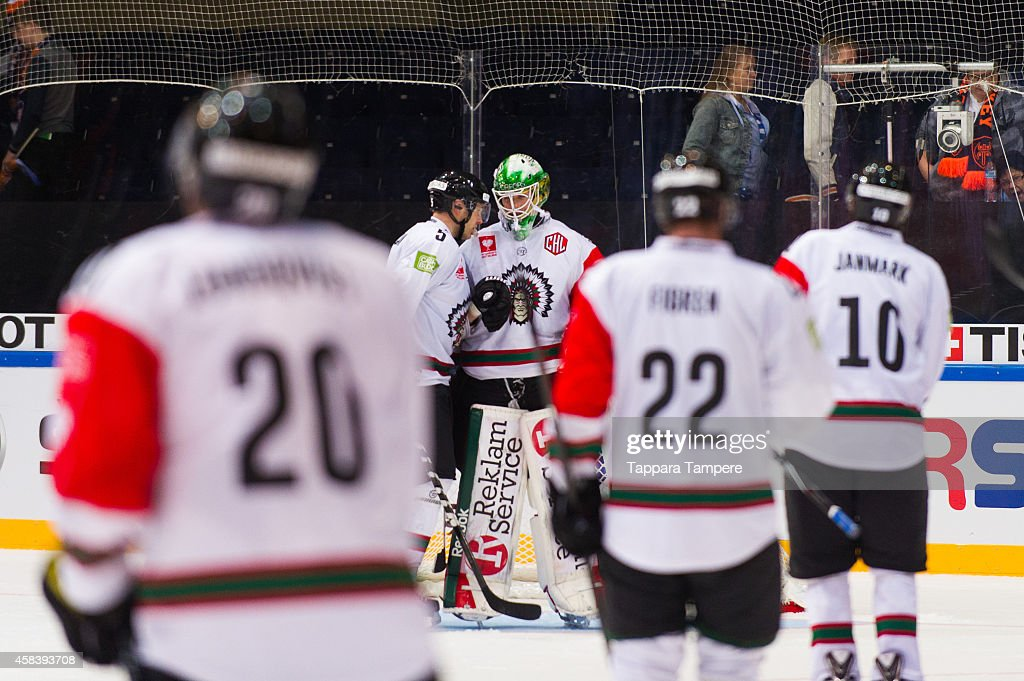 #5 Christian Backman and #35 Linus Fernstrom of Frolunda Gothenburg celebrate their win of Tappara Tampere during the Champions Hockey League round of 16 first leg game between Tappara Tampere and Frolunda Gothenburg at Hakametsa on November 4, 2014 in Tampere, Finland.