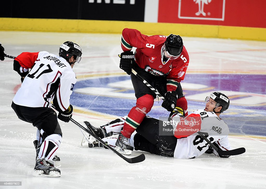 Christian Backman #5 of Frolunda battles Alexandre Picard #81 and Arnaud Jacquemet #17 of Geneve-Servette during the Champions Hockey League group stage game September 4, 2014 in Gothenburg, Sweden.