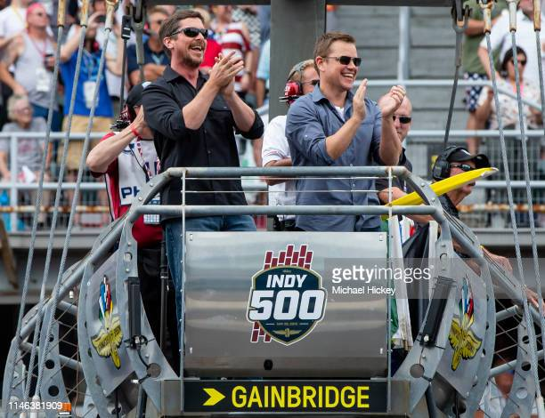 Christian Bale and Matt Damon react after waving the green flag to start the Indy 500 at the Indianapolis Motor Speedway on May 26 2019 in...
