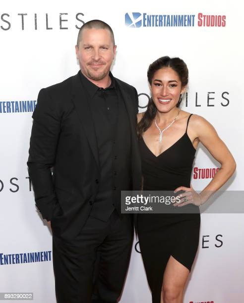 Christian Bale and Q'Orianka Kilcher attend the Premiere Of Entertainment Studios Motion Pictures' 'Hostiles' at Samuel Goldwyn Theater on December...