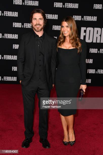 Christian Bale and Sibi Blažić attend the Premiere of FOX's Ford V Ferrari at TCL Chinese Theatre on November 04 2019 in Hollywood California