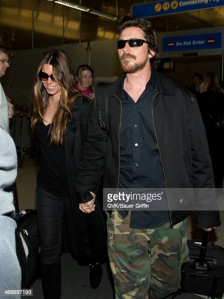 Christian Bale and Sibi Blazic are seen at LAX airport on February 17 2014 in Los Angeles California