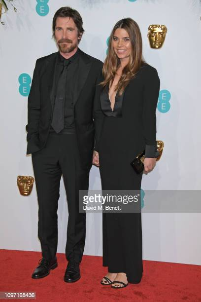 Christian Bale and Sibi Blazic attend the EE British Academy Film Awards at Royal Albert Hall on February 10 2019 in London England
