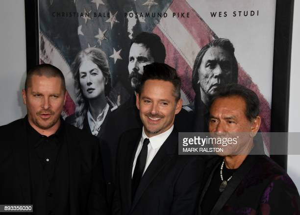 Christian Bale director Scott Cooper and Wes Studi at the premiere of 'Hostiles' in Beverly Hills California on December 14 2017 / AFP PHOTO / Mark...