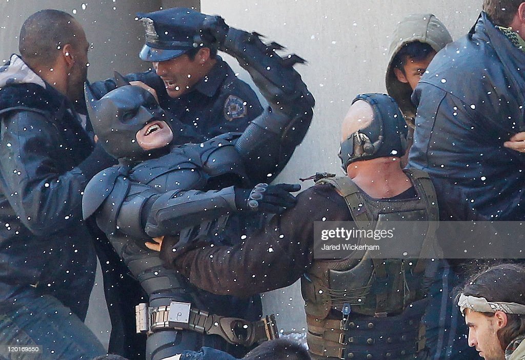 Christian Bale, playing Batman, acts in a scene with Tom Hardy, playing Bane, during the filming of the new Batman: Dark Knight Rises movie at the Mellon Institute building in the Oakland neighborhood of Pittsburgh on July 31, 2011.