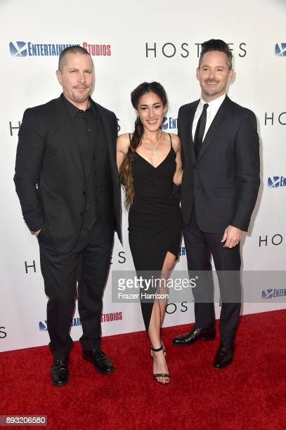 Christian Bale Q'Orianka Kilcher and Scott Cooper attend the premiere of Entertainment Studios Motion Pictures' 'Hostiles' at Samuel Goldwyn Theater...