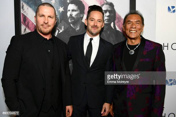 Christian Bale Scott Cooper and Wes Studi attends the premiere of Entertainment Studios Motion Pictures' 'Hostiles' at Samuel Goldwyn Theater on...