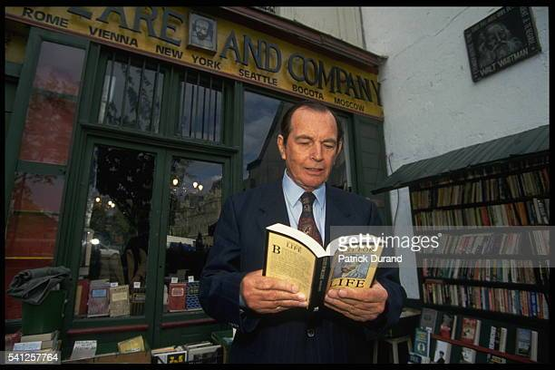 Christian Barnard in front of a bookshop