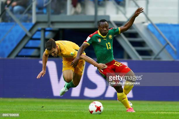 Christian Bassogog of Cameroon and Alex Gersbach of Australia battle for possession during the FIFA Confederations Cup Russia 2017 Group B match...