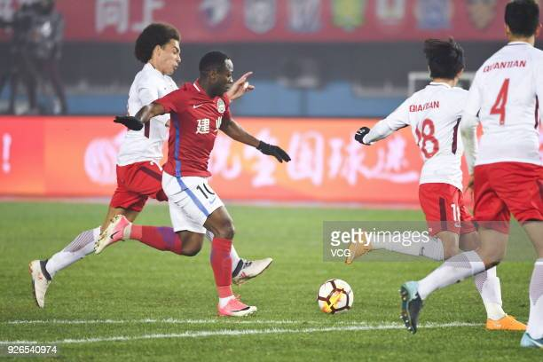 Christian Bassogog of Henan Jianye and Axel Witsel of Tianjin Quanjian compete for the ball during the 2018 Chinese Football Association Super League...