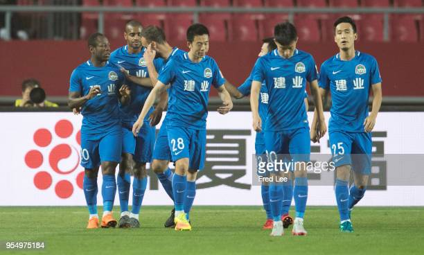 Christian Bassogog of Henan Jianye celebrates scoring his team's goal during 2018 Chinese Super League match between Hebei China Fortune adn Henan...