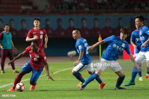Christian Bassogog of Henan Jianye dribbles during the 9th round match of 2017 Chinese Football Association Super League between Henan Jianye and...