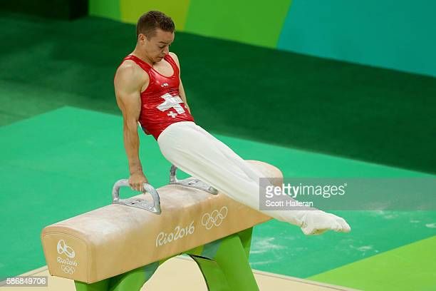 Christian Baumann of Switzerland competes on the pommel horse in the Artistic Gymnastics Men's Team qualification on Day 1 of the Rio 2016 Olympic...