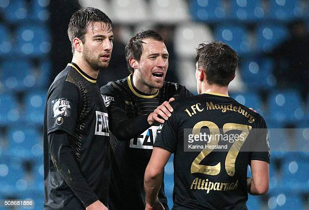 Christian Beck and Steffen Puttkammer talks to Burak Altiparmak of Magdeburg during the Third League match between Chemnitzer FC and 1FC Magdeburg at...