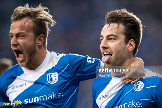 Christian Beck of 1FC Magdeburg celebrates with teammate Felix Lohkemper of 1FC Magdeburg after scoring his team's first goal during the Second...