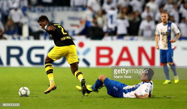 Christian Beck of Magdeburg and Dan Axel Zagadou of Dortmund battle for the ball during the DFB Cup match between 1 FC Magdeburg and Borussia...