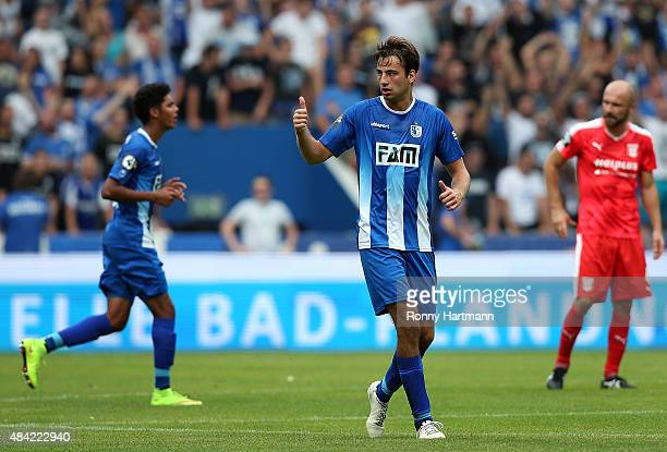 Christian Beck of Magdeburg celebrates after scoring his teams first goal during the Third League match between 1 FC Magdeburg and Hallescher FC at...