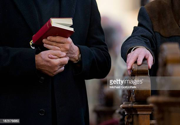 Christian believer holds his hymnal in hand, at the closing mass service of the Fall General Assembly of the German Bishops' Conference in the Fulda...