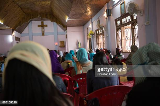 Christian Believers are joining a ceremony inside a church in Kalimpong most of them are wearing a sari