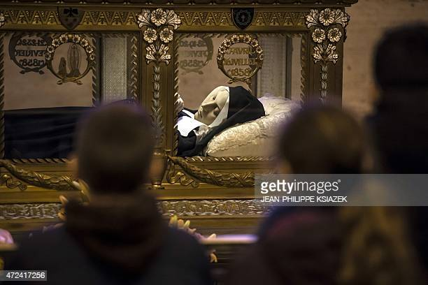 Christian believers visit the shrine in the chapel of the Convent of St Gildard of Nevers where the body of Marie Bernarde Bernadette Soubirous known...