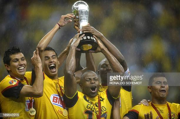 Christian Benitez of America and tammates celebrate with the Mexican Clausura tournament trophy at Azteca stadium in Mexico City on May 26 2013 AFP...