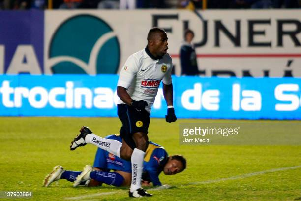 Christian Benitez of America celebrates a scored goal during a match against Estudiantes as part of the Clausura 2012 at Alfonso Lastras Stadium on...