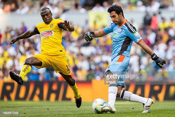 Christian Benitez of America fights for the ball with Sergio Garcia of Queretaro during a Clausura 2013 Liga MX match at Azteca Stadium on February...