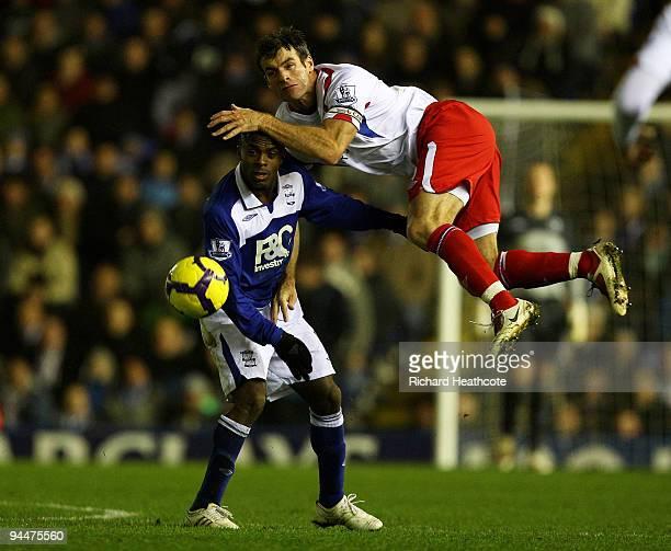 Christian Benitez of Birmingham tussles with Ryan Nelsen of Blackburn during the Barclays Premier League match between Birmingham City and Blackburn...
