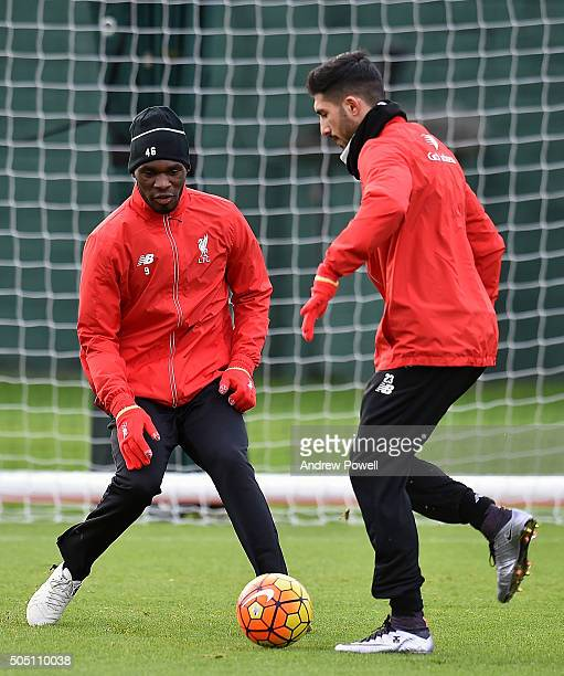 Christian Benteke and Emre Can of Liverpool in action during a training session at Melwood Training Ground on January 15 2016 in Liverpool England