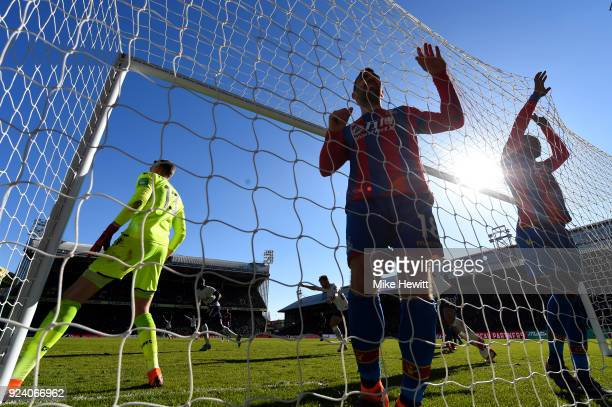 Christian Benteke and James McArthur of Crystal Palace react after Harry Kane of Tottenham Hotspur scored the first goal during the Premier League...