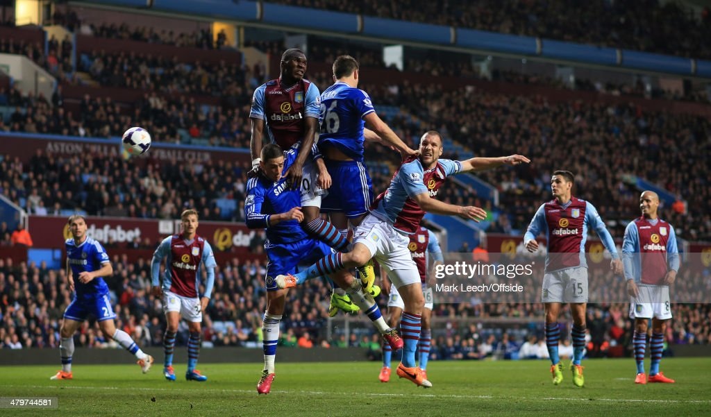 Christian Benteke (L) and Ron Vlaar (R) of Villa battle for a header with Fernando Torres (L) and John Terry (R) of Chelsea during the Barclays Premier League match between Aston Villa and Chelsea at Villa Park on March 15, 2014 in Birmingham, England.