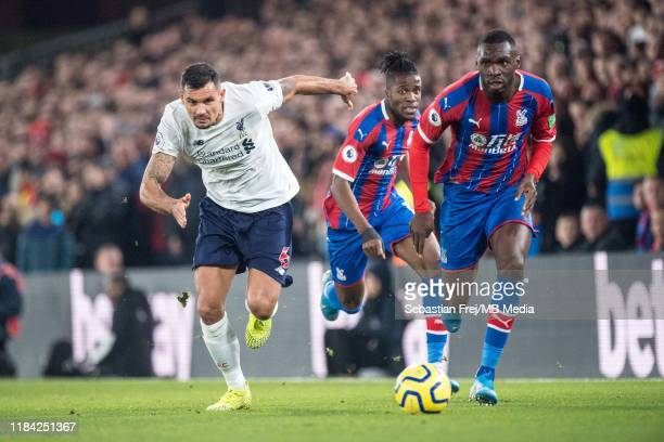 Christian Benteke and Wilfried Zaha of Crystal Palace in action during the Premier League match between Crystal Palace and Liverpool FC at Selhurst...