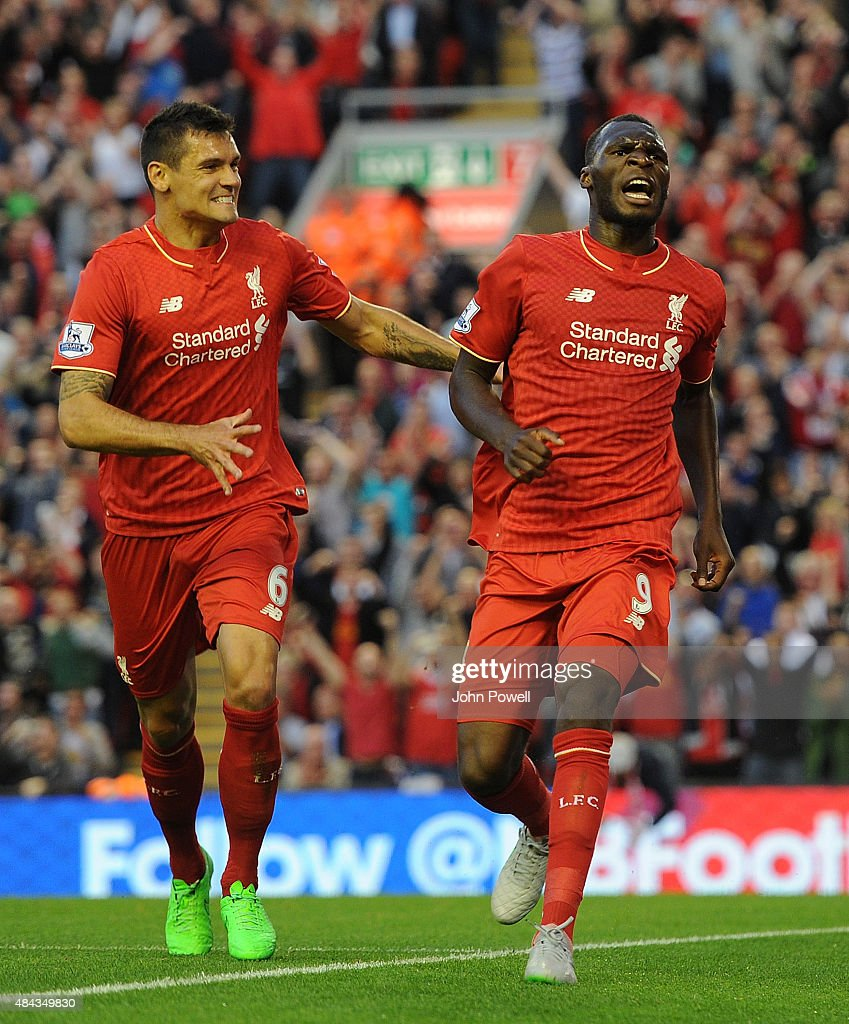 Christian Benteke celebrates his goal with Dejan Lovren of Liverpool during the Barclays Premier League match between Liverpool and A.F.C. Bournemouth on August 17, 2015 in Liverpool, United Kingdom.