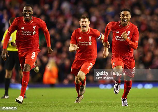 Christian Benteke James Milner and Jordon Ibe of Liverpool celebrate as Joe Allen of Liverpool scores the decisive penalty in the shoot out during...