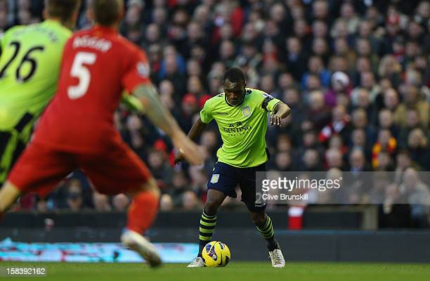 Christian Benteke of Aston Villa about to score the first goal during the Barclays Premier League match between Liverpool and Aston Villa at Anfield...