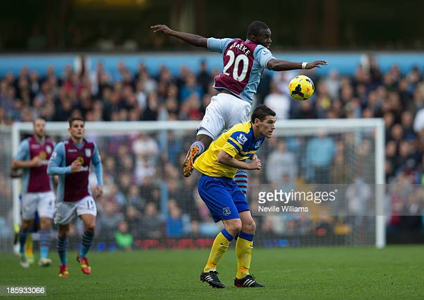 Christian Benteke of Aston Villa and Gareth Barry of Everton in action during the Barclays Premier League match between Aston Villa and Everton at...