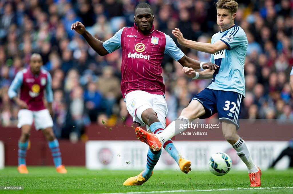 Christian Benteke of Aston Villa and Reece Burke of West Ham in action during the Barclays Premier League match between Aston Villa and West Ham United at Villa Park on May 09, 2015 in Birmingham, England.