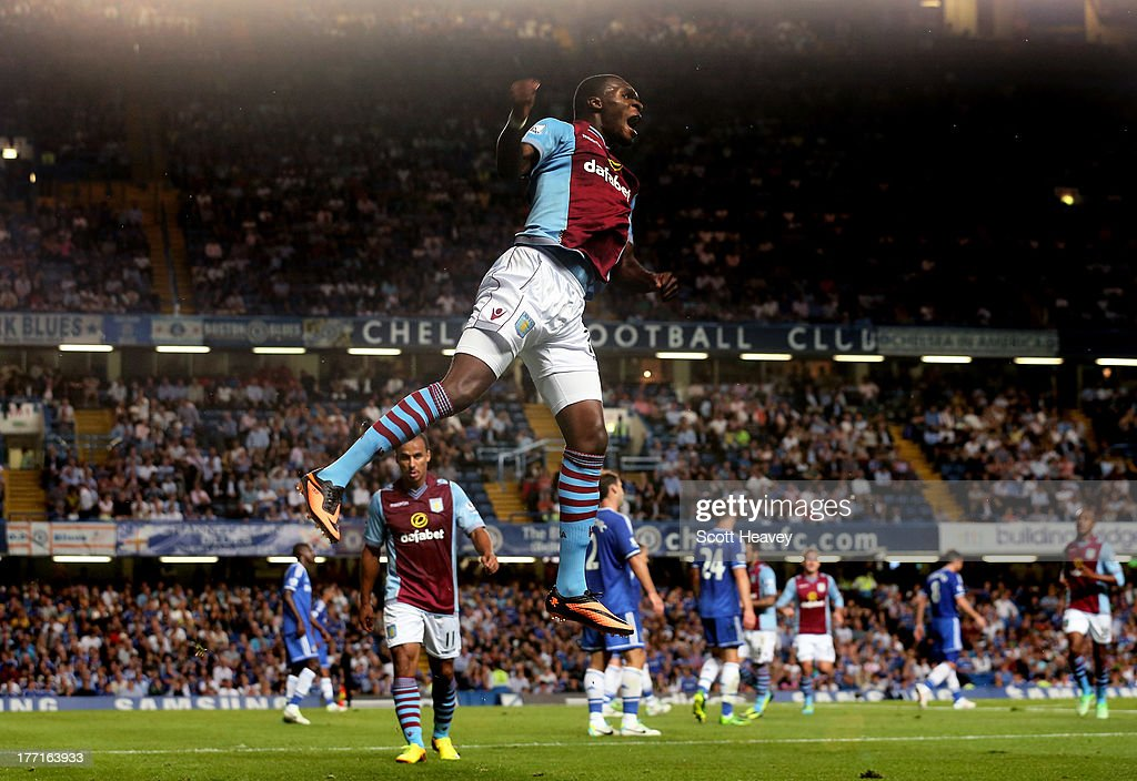 Christian Benteke of Aston Villa celebrates after scoring a goal to level the scores at 1-1 during the Barclays Premier League match between Chelsea and Aston Villa at Stamford Bridge on August 21, 2013 in London, England.