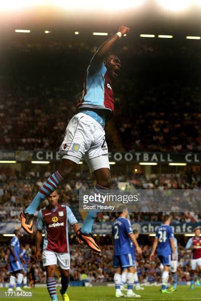 Christian Benteke of Aston Villa celebrates after scoring a goal to level the scores at 11 during the Barclays Premier League match between Chelsea...