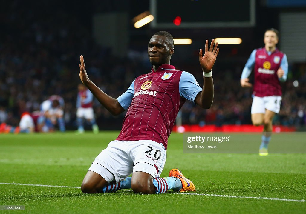 Christian Benteke of Aston Villa (20) celebrates as he scores their second goal during the Barclays Premier League match between Aston Villa and Queens Park Rangers at Villa Park on April 7, 2015 in Birmingham, England.