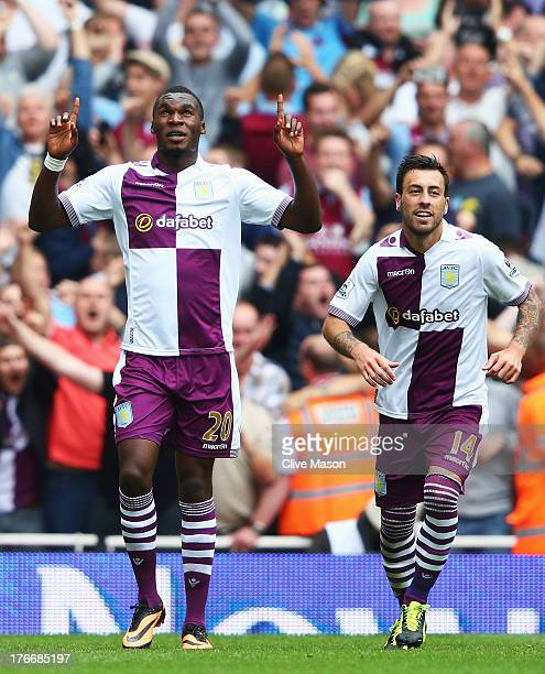 Christian Benteke of Aston Villa celebrates scoring his side's second goal from the penalty spot with team mate Antonio Luna during the Barclays...