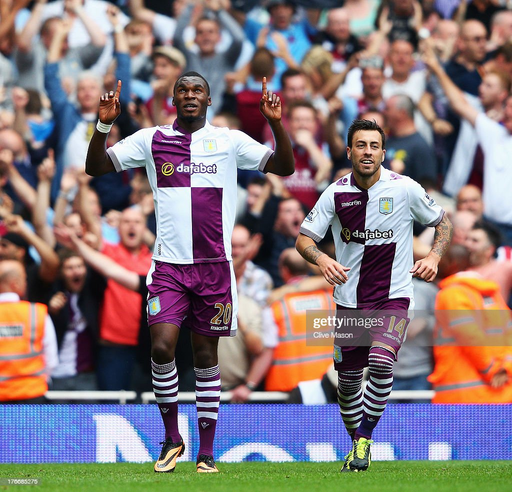 Christian Benteke of Aston Villa (L) celebrates scoring his side's second goal from the penalty spot with team mate Antonio Luna during the Barclays Premier League match between Arsenal and Aston Villa at Emirates Stadium on August 17, 2013 in London, England.